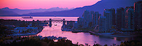 "City of Vancouver Skyline at ""False Creek"" and English Bay, British Columbia, Canada, at Sunset, in Spring.  The Burrard Street Bridge is midground, and the North Shore Mountains (Coast Mountains) rise behind English Bay. - Panoramic View"