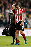 Enda Stevens of Sheffield Utd injured with physio Paul Watson during the Premier League match at Bramall Lane, Sheffield. Picture date: 7th March 2020. Picture credit should read: Simon Bellis/Sportimage