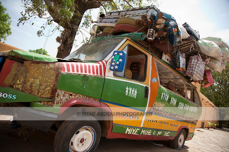 "Exhibit of a ""bush taxi"" loaded with passengers and cargo at the National Museum of Mali in Bamako."