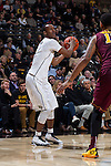 Greg McClinton (11) of the Wake Forest Demon Deacons looks for an open teammate during second half action against the Minnesota Golden Gophers at the LJVM Coliseum on December 2, 2014 in Winston-Salem, North Carolina.  The Golden Gophers defeated the Demon Deacons 84-69. (Brian Westerholt/Sports On Film)