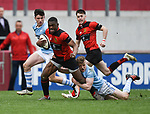 Ikem Ugwueru of Ennis  in action against Kevin Le Gear and Joe O Brien of Garryowen during their U-18 Munster Club Final at Thomond Park. Photograph by John Kelly.