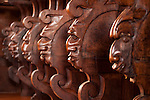 Detail of faces carved on benches in the convent Espaco Corpus Christi in Porto, Portugal.