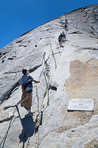CLIMBERS ALONG THE RAILS TO HALF DOME, A NEARLY VERTICLE CLIMB, IN YOSEMITE NATIONAL PARK, CALIFORNIA