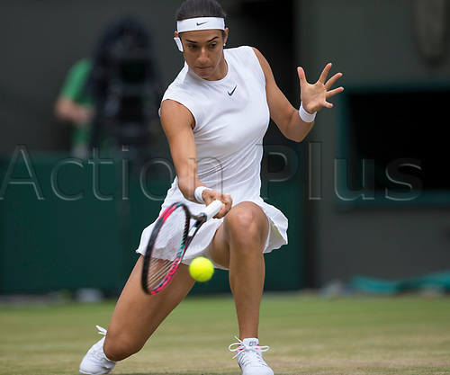 July 10th 2017, All England Lawn Tennis and Croquet Club, London, England; The Wimbledon Tennis Championships, Day 7; Caroline Garcia (FRA) hits a low forehand return to Johanna Konta (GBR)