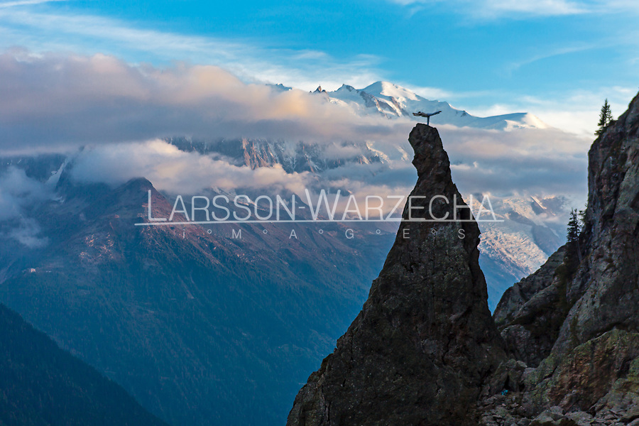 Martina Cufar practicing yoga on top of the Aiguillette d'Argentiere with the Mont Blanc massive in the background.