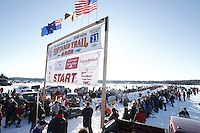 Jessie Royer leaves the start line in Willow, Alaska duirng the re-start of the 2011 Iditarod.
