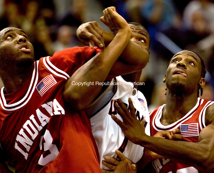 HARTFORD, CT--20 January 2007--012007JS17- UConn's Jeff Adrien, center, gets blocked out by Indiana's D.J. White, left and Roderick Wilmont during their game Saturday at the Hartford Civic Center.<br /> Jim Shannon / Republican-American