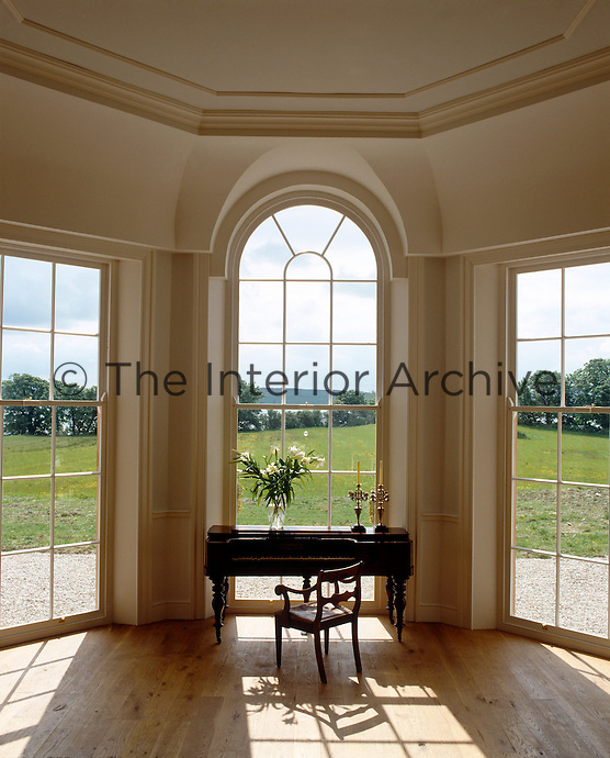 A piano sits in the bay window of the drawing room, its floor to ceiling windows offering a magnificent view over Lough Swilly