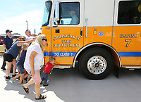 NWA Democrat-Gazette/DAVID GOTTSCHALK Conrad Wilder (right), 2, one of the guests, fire personnel and city officials push Thursday, July 11, 2019, Engine 7 in to the new Springdale Fire Department Fire Station 7 during the ceremonial opening of the station. The station, located on Her-Ber Avenue, was made possible by the passing of the 2018 Bond.