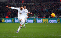 Gylfi Sigurdsson of Swansea takes a free kick during the Barclays Premier League match between Swansea City and Crystal Palace at the Liberty Stadium, Swansea on February 06 2016