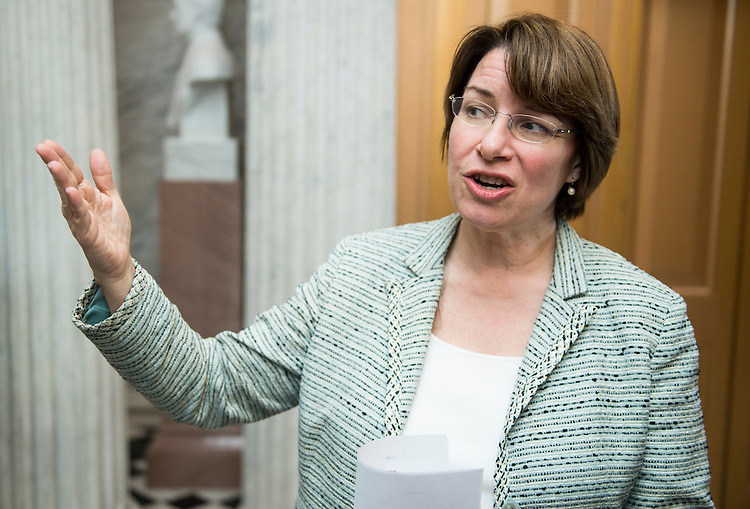"UNITED STATES - MARCH 22: Sen. Amy Klobuchar, D-Minn., speaks with reporters before the ""Vote-A-Rama"" on amendments to the budget resolution on Friday, March 22, 2013. (Photo By Bill Clark/CQ Roll Call)"