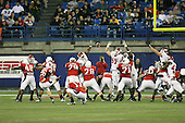 January 5th, 2008:  Ball State place kicker Ian McGarvey (26) kicks an extra point as Rutgers defenders try to block the kick during the third quarter of the International Bowl at the Rogers Centre in Toronto, Ontario Canada...Rutgers defeated Ball State 52-30.  ..Photo By:  Mike Janes Photography
