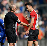 Referee Mike Dean &amp; Southampton's Maya Yoshida <br /> <br /> Photographer David Horton/CameraSport<br /> <br /> The Premier League - Southampton v Chelsea - Saturday 14th April2018 - St Mary's Stadium - Southampton<br /> <br /> World Copyright &copy; 2018 CameraSport. All rights reserved. 43 Linden Ave. Countesthorpe. Leicester. England. LE8 5PG - Tel: +44 (0) 116 277 4147 - admin@camerasport.com - www.camerasport.com