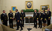 United States President Barack Obama shakes hands with Captain Jose Belardo, Officer-in-Charge, Team 4, after meeting with members of the Public Health Service Commissioned Corps (PHS CC) after signing a citation awarding the Presidential Unit Citation to PHS CC members who participated in the Ebola containment efforts in West Africa, in the Oval Office at The White House in Washington, D.C., U.S., on Thursday, Sept. 24, 2015. <br /> Credit: Rod Lamkey Jr. / Pool via CNP