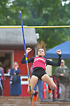 A pole vaulter after clearing the bar.