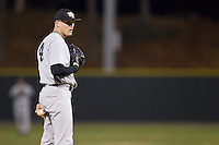 Wake Forest Demon Deacons relief pitcher Mark McCoy (41) looks to his catcher for the sign against the Davidson Wildcats at Wilson Field on March 19, 2014 in Davidson, North Carolina.  The Wildcats defeated the Demon Deacons 7-6.  (Brian Westerholt/Four Seam Images)