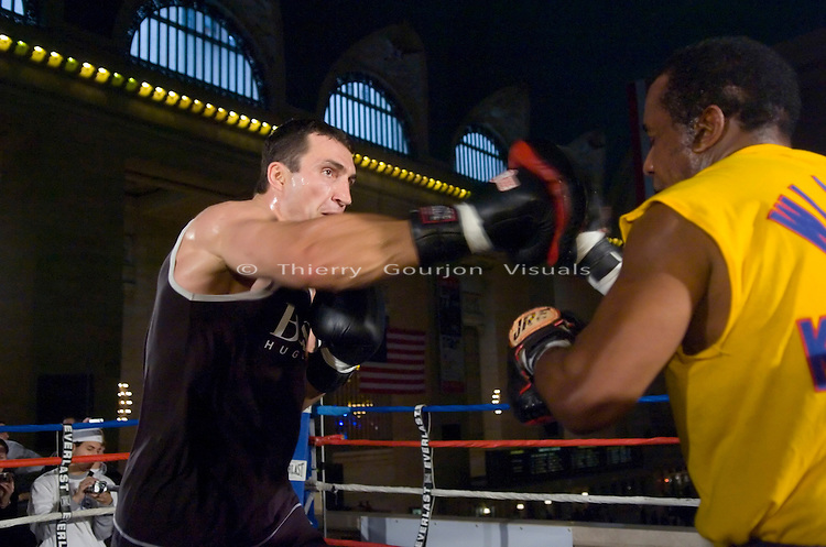 Wladimir Klitschko works the pads with trainer Emmanuel Stewart during an open training session at Grand Central Station, N.Y. on 11.07.06..Klitschko is preparing for his heavyweight fight against contender Calvin Brock at Madison Square Garden in N.Y.C on 11.11.06.<br />
