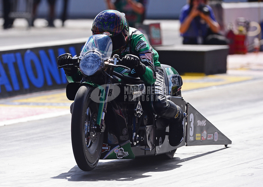 Sept. 14, 2012; Concord, NC, USA: NHRA pro stock motorcycle rider Andrew Hines during qualifying for the O'Reilly Auto Parts Nationals at zMax Dragway. Mandatory Credit: Mark J. Rebilas-