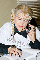 """Wearing a """"Women For Trump"""" shirt, Blanca Vrotsos, 62, of Doral, Florida, has been volunteering almost everyday for 10 months at the Donald Trump campaign office in Hialeah, Miami, Florida. She helps recruit volunteers, register people to vote, and train other volunteers. Originally from Cuba, she has been a US citizen for 15 years and says she is """"extremely Republican."""" She first voted in 2000 and voted for George W. Bush. She says she will always support the Republican nominee for president."""
