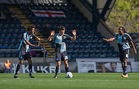 Sido Jombati (L) of Wycombe Wanderers & Marcus Bean (R) of Wycombe Wanderers calm Luke O'Nien of Wycombe Wanderers down as his goes to take a quick free kick during the Sky Bet League 2 match between Wycombe Wanderers and Plymouth Argyle at Adams Park, High Wycombe, England on 12 September 2015. Photo by Andy Rowland.