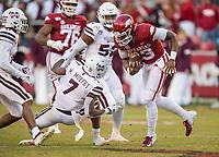 NWA Democrat-Gazette/BEN GOFF @NWABENGOFF<br /> K.J. Jefferson, Arkansas quarterback, breaks the tackle of Marcus Murphy, Mississippi State free safety, in the fourth quarter Saturday, Nov. 2, 2019, at Reynolds Razorback Stadium in Fayetteville.