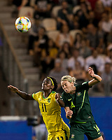 GRENOBLE, FRANCE - JUNE 18: Khadija Shaw #11 of the Jamaican National Team, Alanna Kennedy #14 of the Australian National Team battle for head ball during a game between Jamaica and Australia at Stade des Alpes on June 18, 2019 in Grenoble, France.