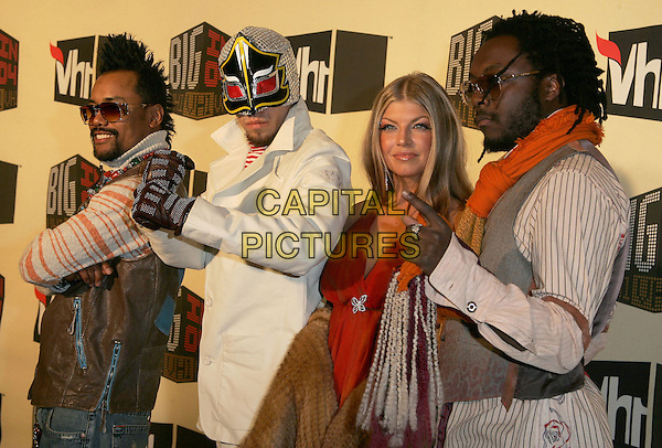 BLACK EYED PEAS - APL.DE.AP, TABOO, FERGIE & WIL.I.AM.The VH1 Big in 04  Award Show held at The Shrine Auditorium in Los Angeles, California .December 1, 2004.half length, sunglasses, shades, pointing, gesture, mask, dress-up, costume.www.capitalpictures.com.sales@capitalpictures.com.Supplied by Capital Pictures