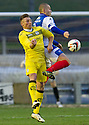 Queen of the South's Chris Mitchell and Cowdenbeath's Kenny Adamson challenge for the ball.