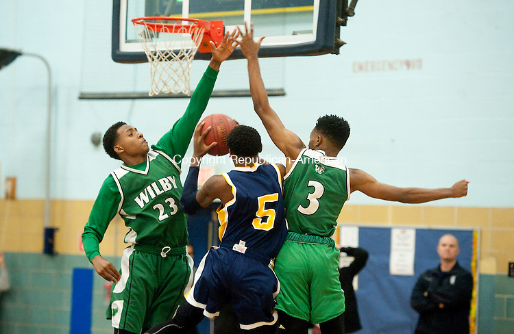 WATERBURY, CT--- -121915JS20--Kennedy's Jaivaun McKnight (5) tries to put up a shot between Wilby's Ahman Alves (23) and Dimitri Yates (3) during the annual boys basketball jamboree held Saturday at Kennedy High School in Waterbury, <br /> Jim Shannon Republican-American