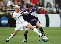 Penn State\\\'s Zoe Bouchelle (33) grabs onto the jersey of Portland\\\'s Christine Sinclair (12). The University of Portland Pilots defeated the Penn State University Nittany Lions 3-2 in a penalty kick shootout after the teams played to a 0-0 overtime tie a