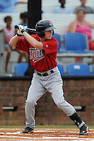 Designated hitter Tanner English (23) of the Elizabethton Twins bats in a game against the Johnson City Cardinals on Sunday, July 27, 2014, at Howard Johnson Field at Cardinal Park in Johnson City, Tennessee. The game was suspended due to weather in the fifth inning. (Tom Priddy/Four Seam Images)