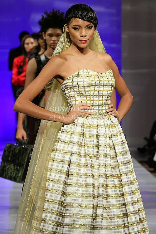 Model walks runway in an outfit from the Marisol Henriquez Fall 2013 collection, during Couture Fashion Week New York Fall 2013, on February 15, 2013.