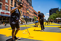 """NEW YORK, NEW YORK - June 14: People work on the """"Black Lives Matter"""" mural on Fulton St in the Bedford - Stuyvesant neighborhood on June 14, 2020 in Brooklyn, NY. Protesters continue Nationwide after the death of George Floyd. (Photo by Pablo Monsalve/VIEWpress via Getty Images)"""