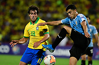 BUCARAMANGA - COLOMBIA, 06-02-2020: Igor Silveira Gomes de Brasil disputa el balón con Agustin Oliveros de Uruguay durante partido entre Brasil U-23 Y Uruguay U-23 por el cuadrangular final como parte del torneo CONMEBOL Preolímpico Colombia 2020 jugado en el estadio Alfonso Lopez en Bucaramanga, Colombia. / Igor Silveira Gomes of Brazil fights the ball with Agustin Oliveros of Uruguay during the match between Brazil U-23 and Uruguay U-23 for the final quadrangular as part of CONMEBOL Pre-Olympic Tournament Colombia 2020 played at Alfonso Lopez stadium in Bucaramanga, Colombia. Photo: VizzorImage / Julian Medina / Cont