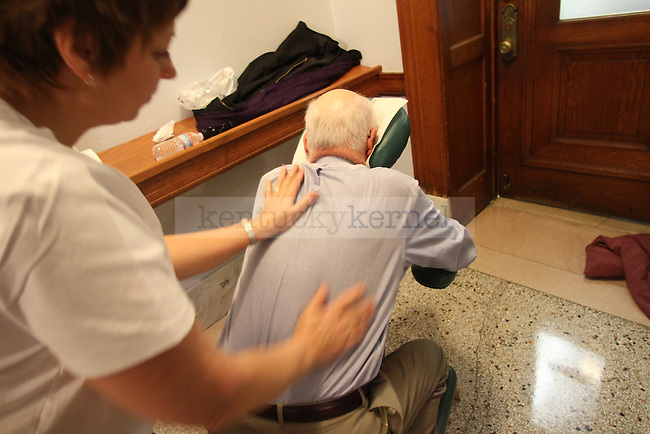 Wendell Berry receives a free massage by Bonnie Arndt on Sunday morning, Feb. 12, 2011. Photo by Brandon Goodwin| Staff
