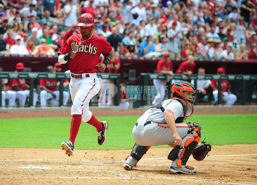 Apr. 8, 2012; Phoenix, AZ, USA; Arizona Diamondbacks base runner Chris Young (left) scores safely ahead of the tag by San Francisco Giants catcher Buster Posey in the fourth inning at Chase Field. Mandatory Credit: Mark J. Rebilas-