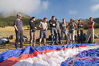Saint Vincent-les-Forts, Lac de Serre Poncon, France, September 2007. Instructor Aniek Peters, shows a paraglider to new students.  Volantis is home to the paragliding school Inferno. In one week time, students learn to fly the paraglider and earn their mountain licence 1. Photo by Frits Meyst/Adventure4ever.com