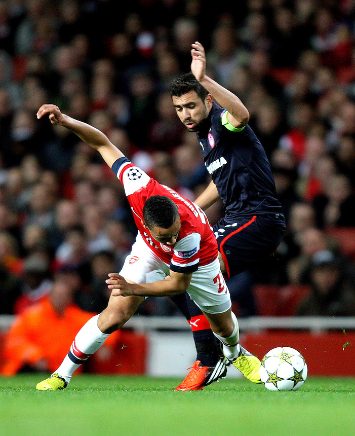 Arsenal's Francis Coquelin battles with Olympiakos' Giannis Maniatis ..Football - UEFA Champions League Group B - Arsenal v Olympiakos FC - Wednesday 3rd October 2012 - Emirates Stadium - London..
