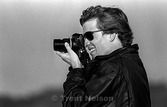 Andrew Holloway with camera at Ocean Beach.<br />