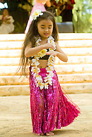 A young hula dancer performs at Kapiolani park bandstand on May day, also known in Hawaii as lei day