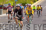 Cyclists pass through the streets of Athea last Monday in aid of the Brothers of Charity Listowel and Newcastle West.
