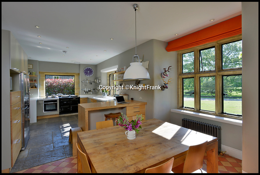 BNPS.co.uk (01202 558833)Pic: KnightFrank/BNPS<br /> <br /> Kitchen and dining area.<br /> <br /> A country manor house which once inspired Victorian author Thomas Hardy has gone on the market for £2.35m.<br /> <br /> The writer was friends with the former owners of Hilfield Manor and visited the property over 100 years ago.<br /> <br /> Indeed, there is a photograph of him with his wife Florence stood in the front porch.<br /> <br /> The manor is in the Dorset village of Hermitage, which Hardy called Little Hintock in his novel The Woodlanders.<br /> <br /> The property was built in the late 19th century by the Dampier-Bide family who were descendants of the famous British explorer and privateer William Dampier.