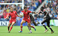 Wales's Luke Morgan evades the tackle of Kenya's Emonyi Collins Injera<br /> <br /> Kenya Vs Wales - men's placing 5-8 match<br /> <br /> Photographer Chris Vaughan/CameraSport<br /> <br /> 20th Commonwealth Games - Day 4 - Sunday 27th July 2014 - Rugby Sevens - Ibrox Stadium - Glasgow - UK<br /> <br /> © CameraSport - 43 Linden Ave. Countesthorpe. Leicester. England. LE8 5PG - Tel: +44 (0) 116 277 4147 - admin@camerasport.com - www.camerasport.com