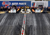 Feb 22, 2014; Chandler, AZ, USA; NHRA funny car driver Jack Beckman (left) races alongside Matt Hagan during qualifying for the Carquest Auto Parts Nationals at Wild Horse Pass Motorsports Park. Mandatory Credit: Mark J. Rebilas-USA TODAY Sports
