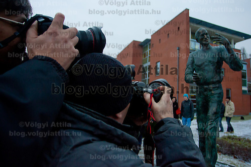 Photographers take a photo of the first ever life-size bronze statue of late Apple leader Steve Jobs after the inauguration ceremony in Budapest, Hungary on December 21, 2011. ATTILA VOLGYI
