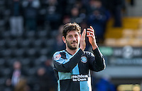 Joe Jacobson of Wycombe Wanderers applauds the support during the Sky Bet League 2 match between Notts County and Wycombe Wanderers at Meadow Lane, Nottingham, England on 28 March 2016. Photo by Andy Rowland.