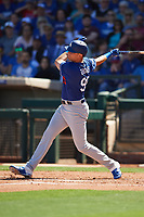 Cody Thomas (95) of the Los Angeles Dodgers follows through on a swing during a Cactus League Spring Training game against the Texas Rangers on March 8, 2020 at Surprise Stadium in Surprise, Arizona. Rangers defeated the Dodgers 9-8. (Tracy Proffitt/Four Seam Images)