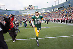 Green Bay Packers quarterback Aaron Rodgers (12) runs off the field after a Week 11 NFL football game against the Tampa Bay Buccaneers on November 20, 2011 in Green Bay, Wisconsin. The Packers won 35-26. (AP Photo/David Stluka)