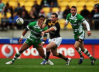 Wellington halfback Alby Mathewson passes under pressure from Johnny Leota. Air NZ Cup - Wellington Lions v Manawatu Turbos at Westpac Stadium, Wellington, New Zealand. Saturday 3 October 2009. Photo: Dave Lintott / lintottphoto.co.nz