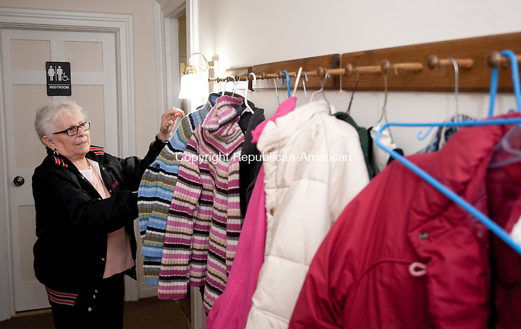 PLYMOUTH, CT--- -112015JS04--Terri LaFountain of Bristol looks over wearers and jackets during the Clothes Closet Giveaway Friday at the First Baptist Church in Plymouth. The event  continues today from 10am to 4pm. All are welcome to pick out sizes and styles and take whatever clothing is appropriate for their needs. <br /> Jim Shannon Republican-American